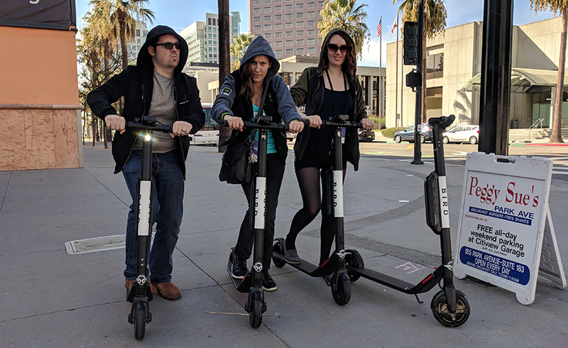 Dauntless' Ian Tornay, Victoria Wojcik, and RuthAnne Berry debate the merits of starting an official Phoenix Labs Scooter Club